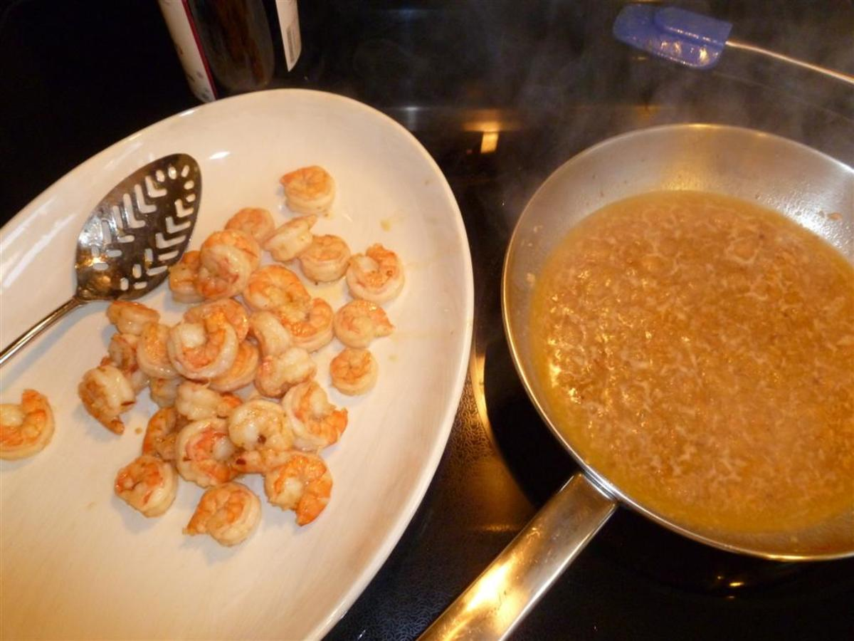 Using a slotted spoon, remove the shrimp from the oil so you can reduce the oil and sherry mixture without overcooking the shrimp.