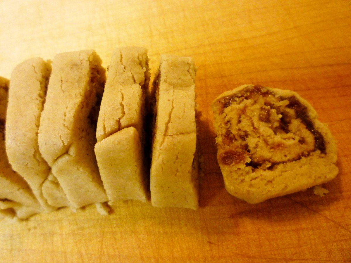 Slicing the cookie rolls prior to baking