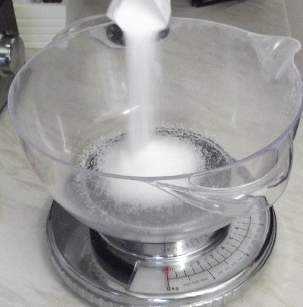 weight the sugar and add to the mixing bowl