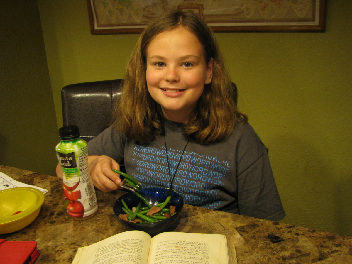 Sophie eating her own recipe:  Green Beans with Turkey Bacon!  She makes these almost every night for us!