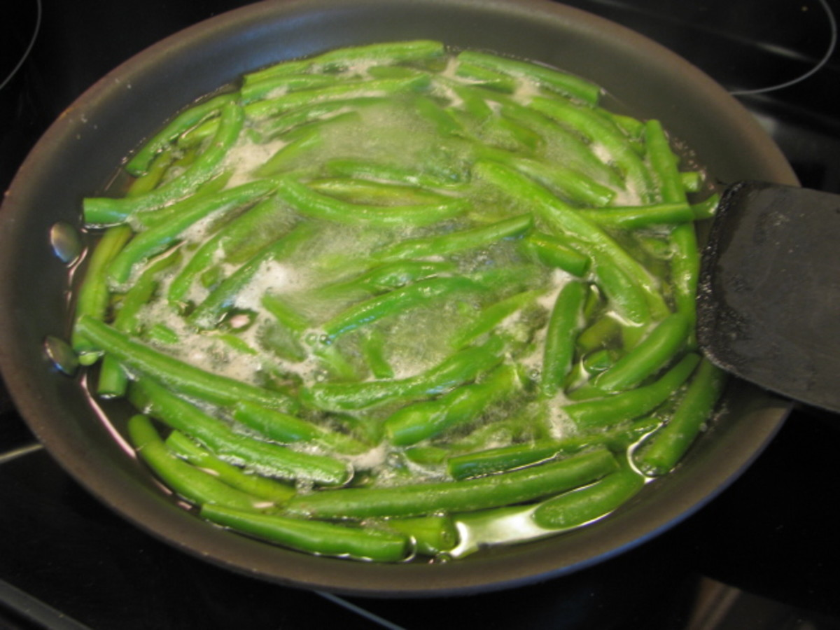 To parboil fresh beans, first cut off the ends of the beans, put them in the pan and cover them with water.  Put the heat on and boil for 5 minutes.  Get an adult to help you pour off the water. Then put the green beans aside and follow the recipe.