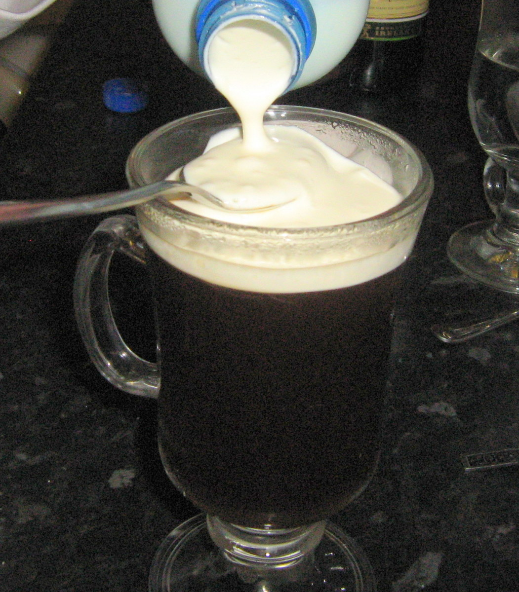 Slowly pour the cream onto the slightly angled spoon. Let the cream fall off the spoon into the glass and it will not sink.