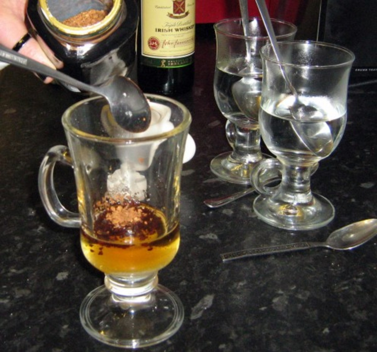 Add 1 1/2 teaspoons of instant coffee to each glass.