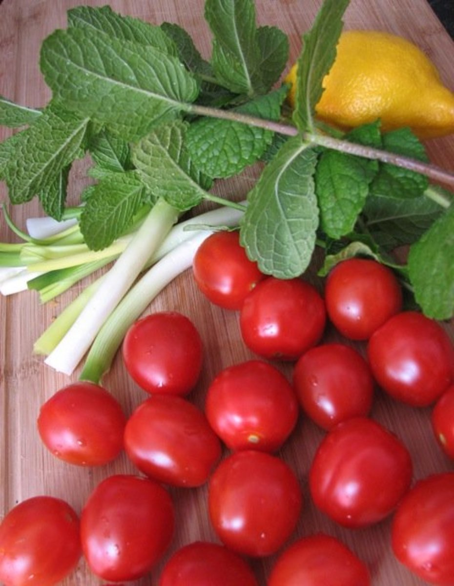 Fresh, homegrown mint, lemon, spring onions and mini-roma tomatoes.