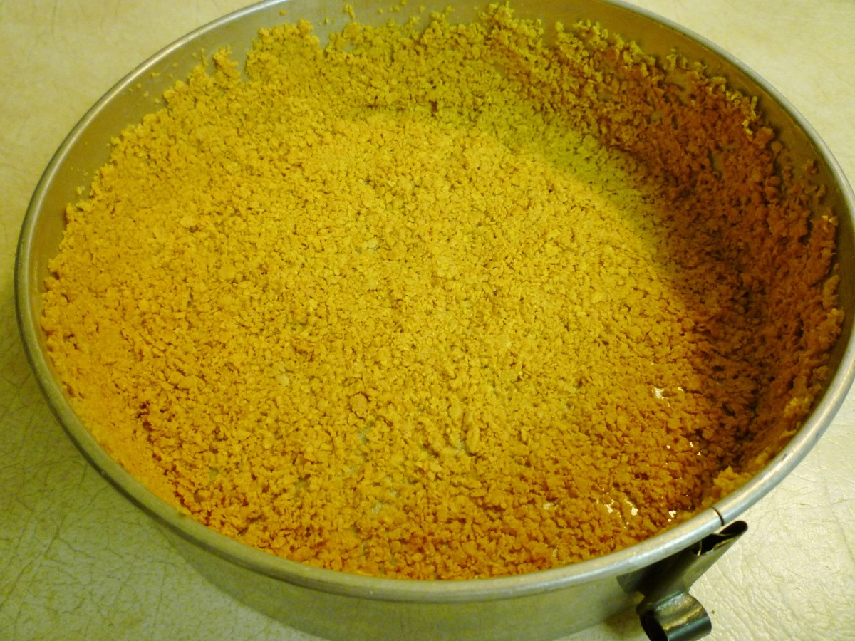 Pressed the cornflake mixture into the springform pan and then chilled it in the refrigerator before adding the filling.