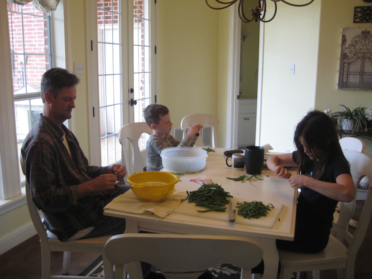 Snapping beans by yourself can get tedious, but when done as a family project, it's actually fun, relaxing, and a great opportunity to tell jokes and stories.