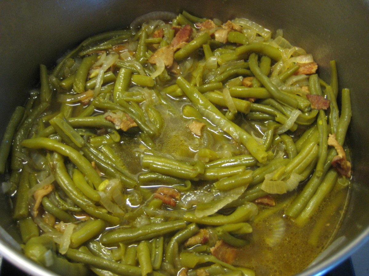 After the beans are fully cooked and wilted, they are tender, perfectly seasoned and delicious. The thin onion slices are just about invisible at this point in the cooking process.