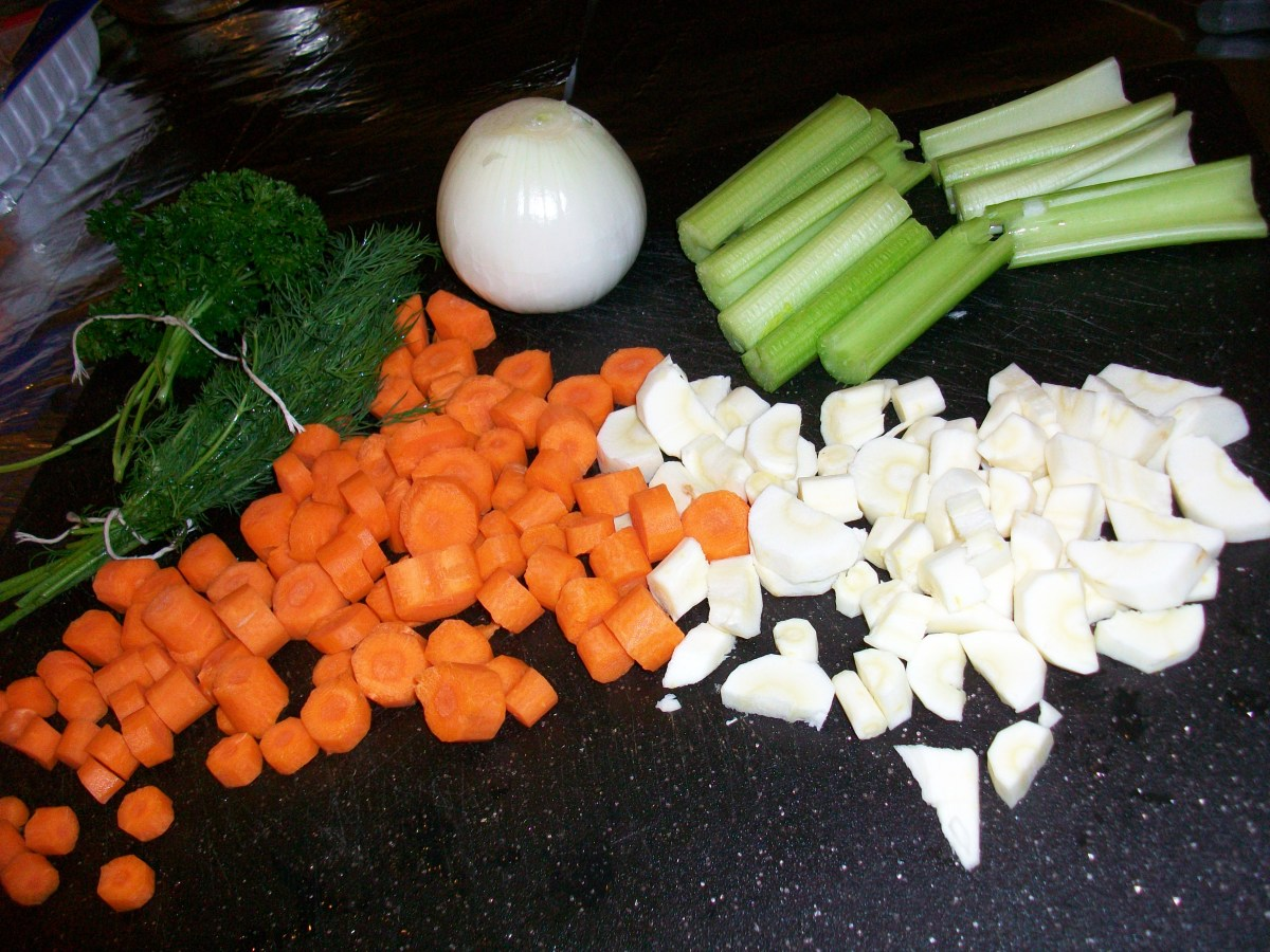 Parsely, dill, onions, celery, parsnips, and carrots: the veggies and herbs you need for a traditional Jewish chicken soup.