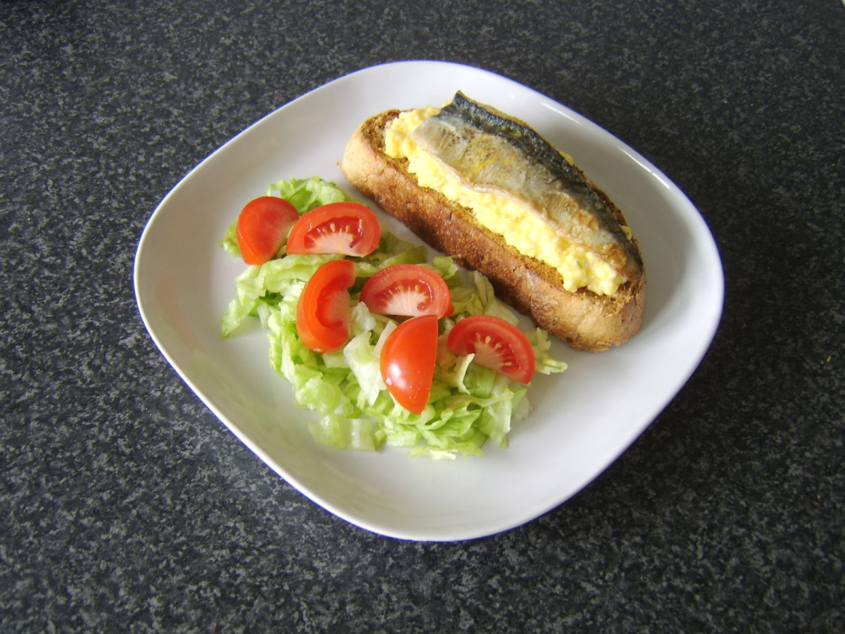 Simple pan fried mackerel fillet and scrambled eggs are included on wheat, spelt and rye toast and served with a simple salad
