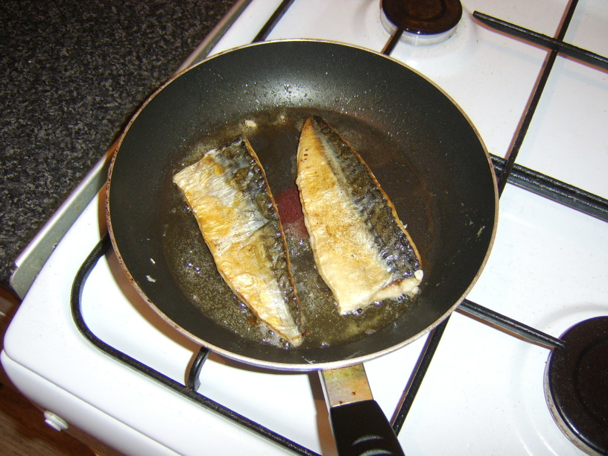 Mackerel fillets are turned at the last minute to complete cooking on the flesh sides