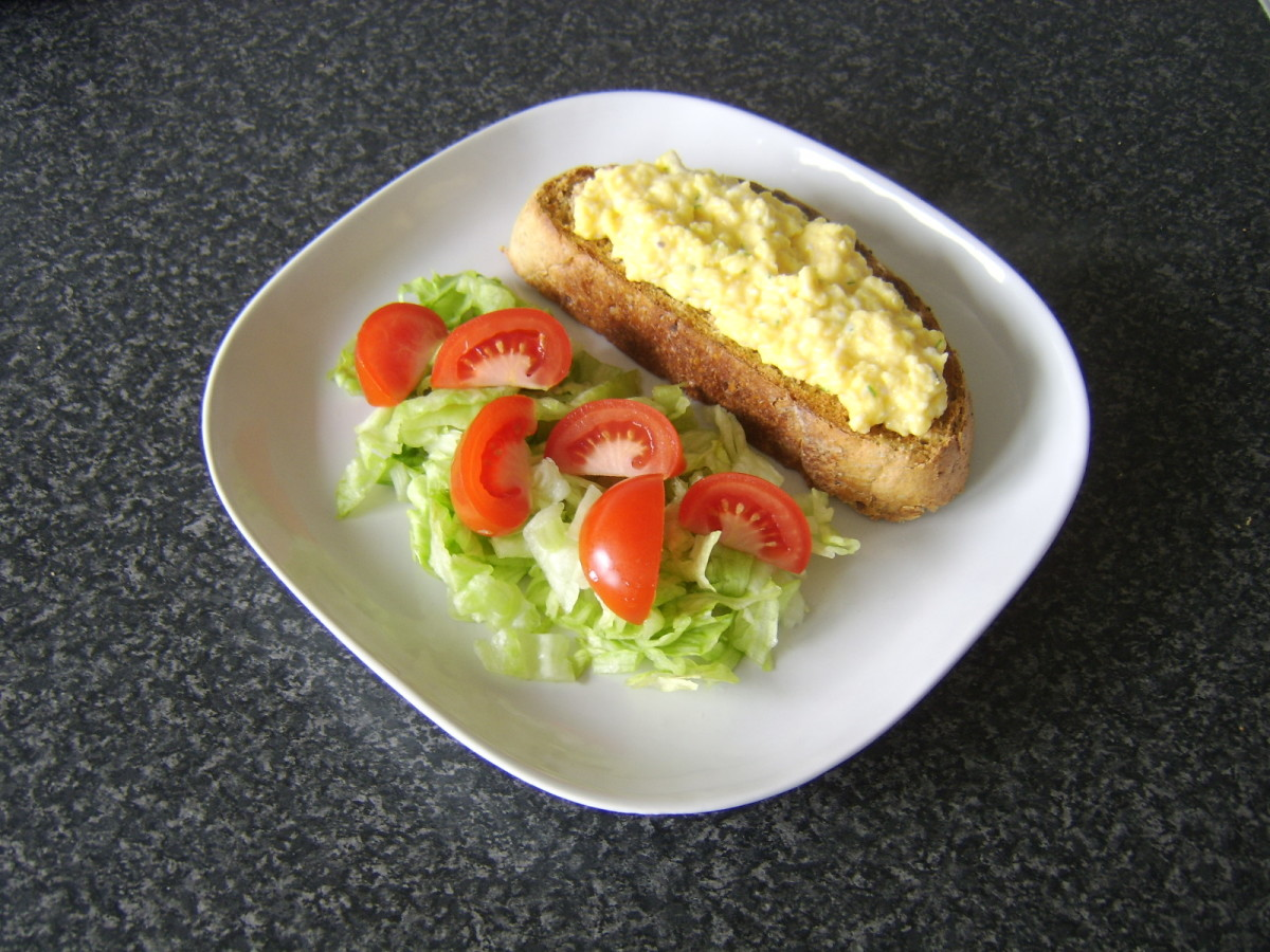 Scrambled egg is added to toast