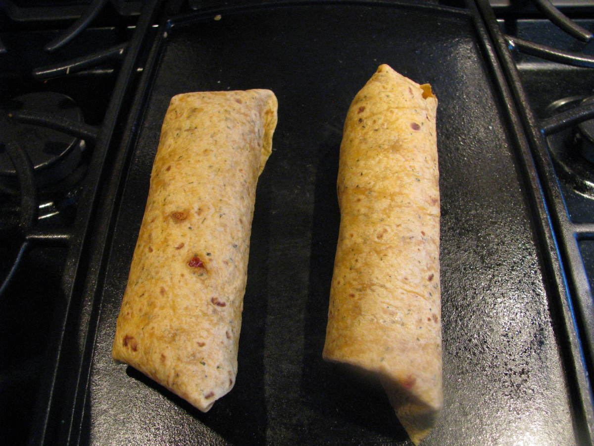Two burritos in sundried tomato tortilla wraps