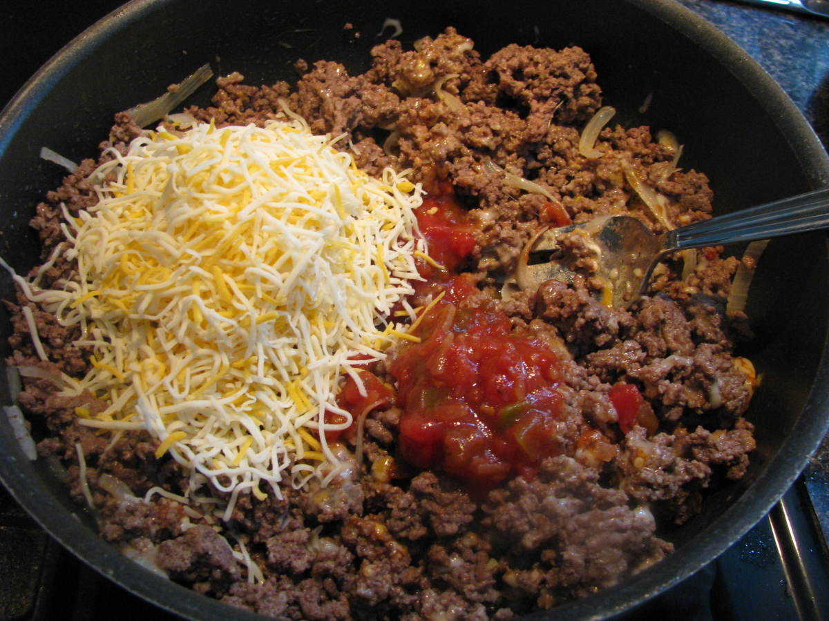 Add in shredded cheese and salsa.
