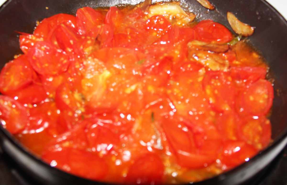 Added tomatoe to the pan and cooked it until it is soft.