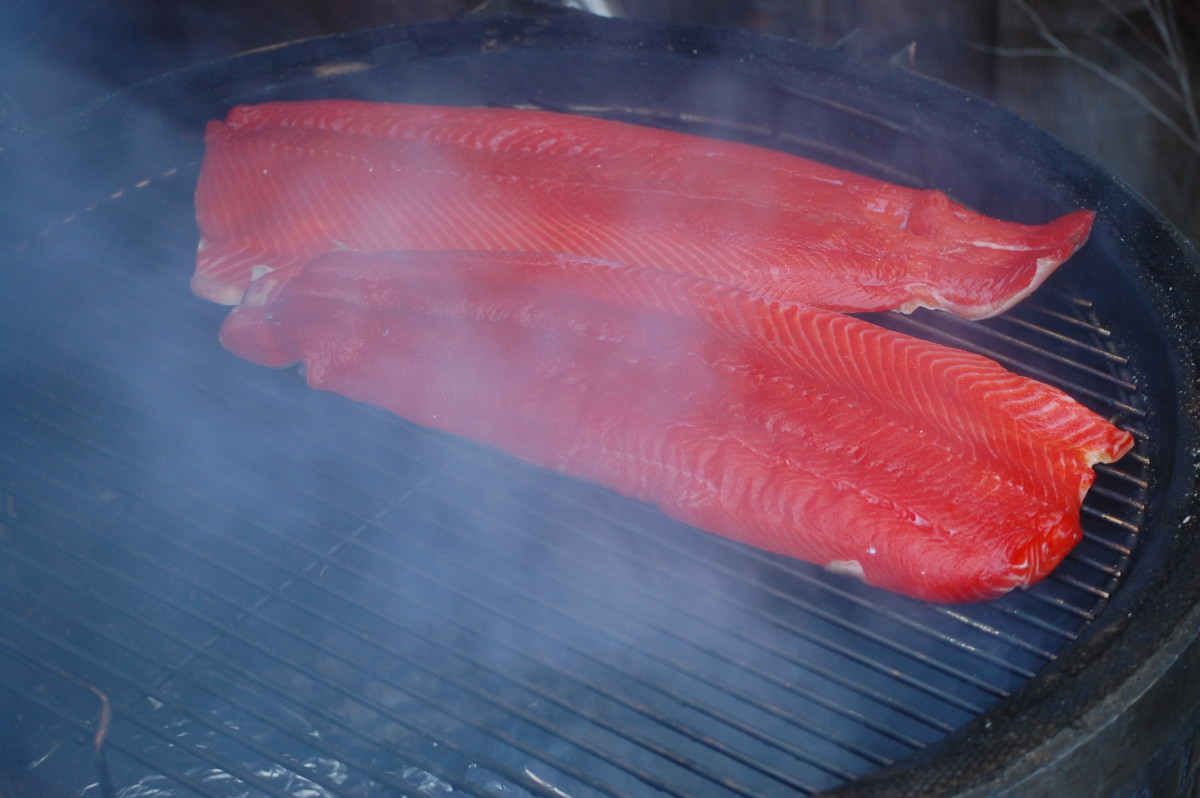 Salmon smoking on grill