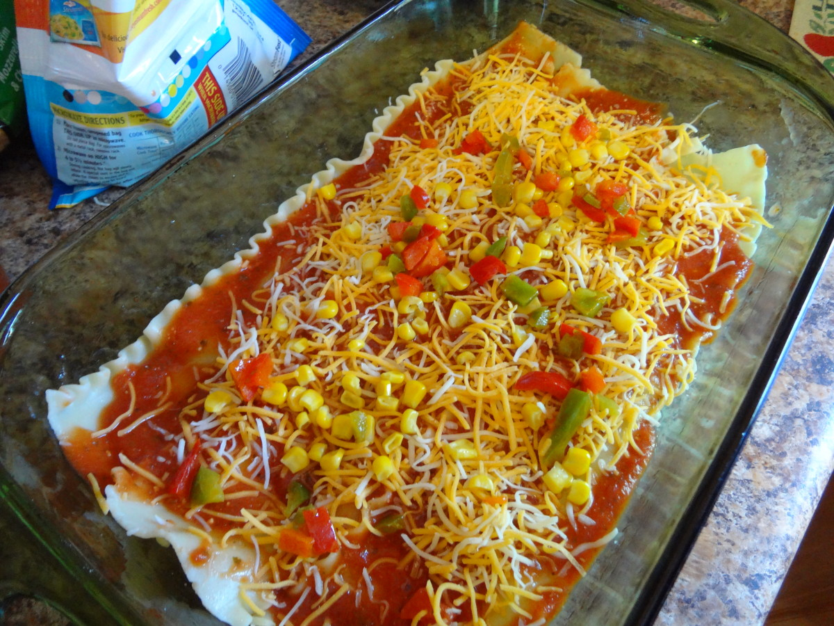 Add a layer of sauce, sprinkle on some veggies and some cheese.