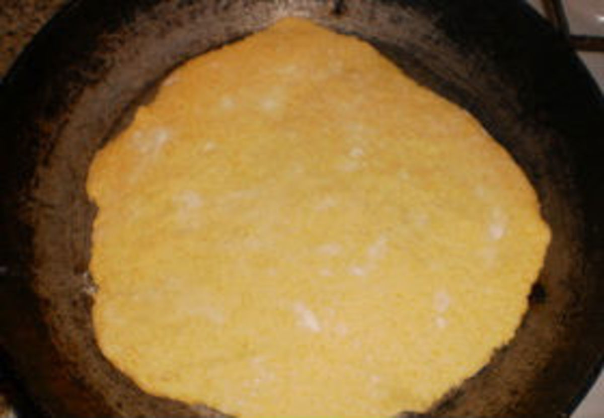 Divide dough onto 10-12 pieces, roll each of them into tortilla and fry each tortilla on a heated pan without butter or oil.