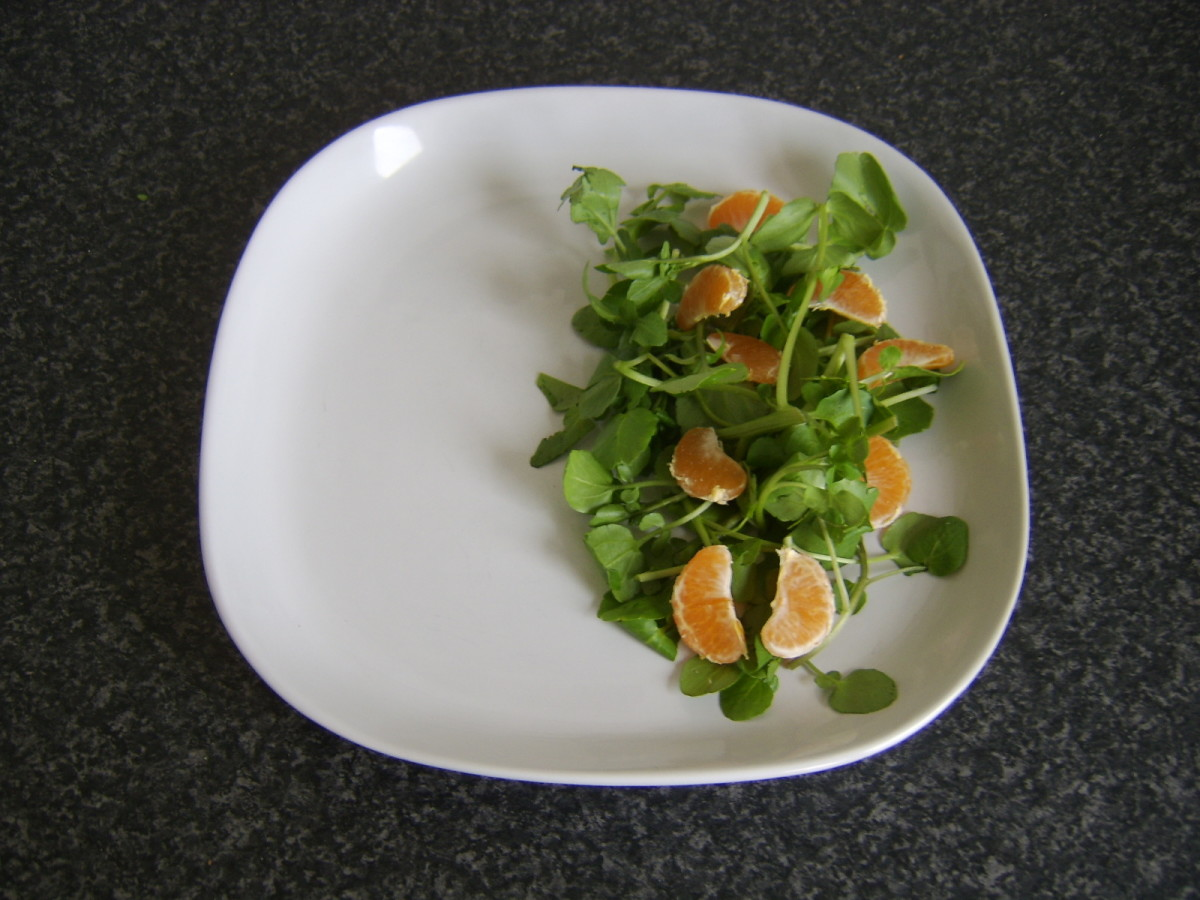 Watercress and satsuma segmnets are plated