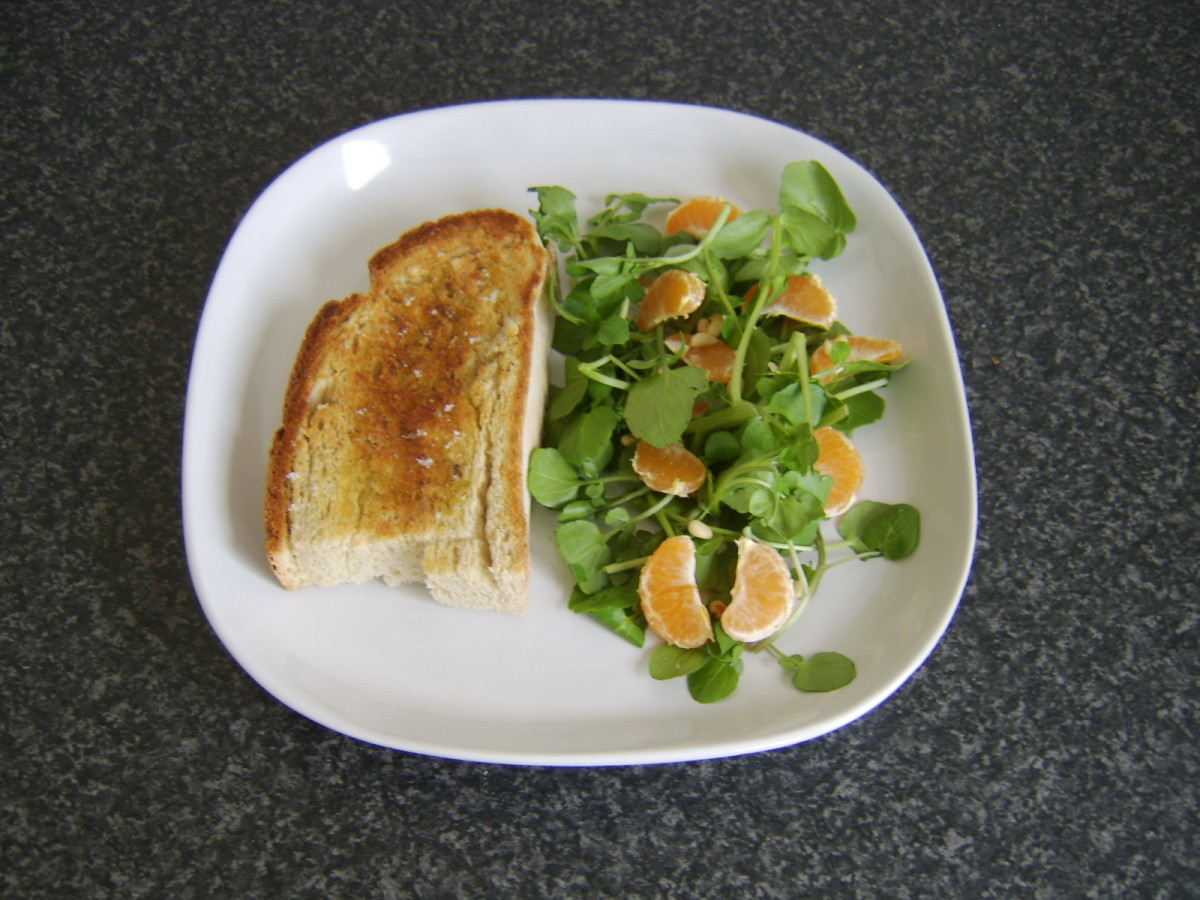 Toast is plated beside salad