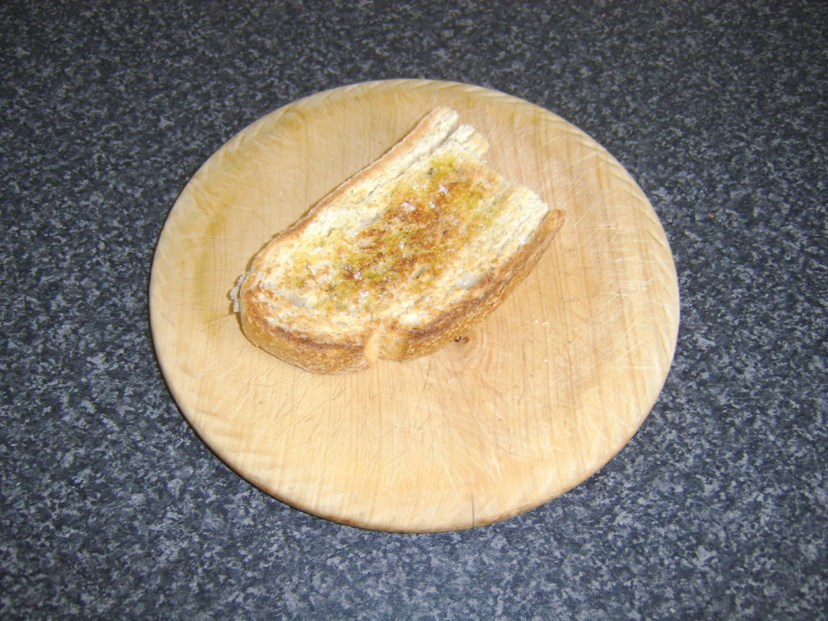 Extra virgin olive oil, salt and pepper are added to toast