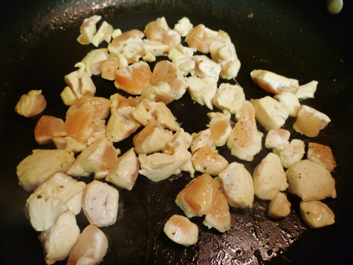 Add the chicken pieces to the same pan and cook until done.