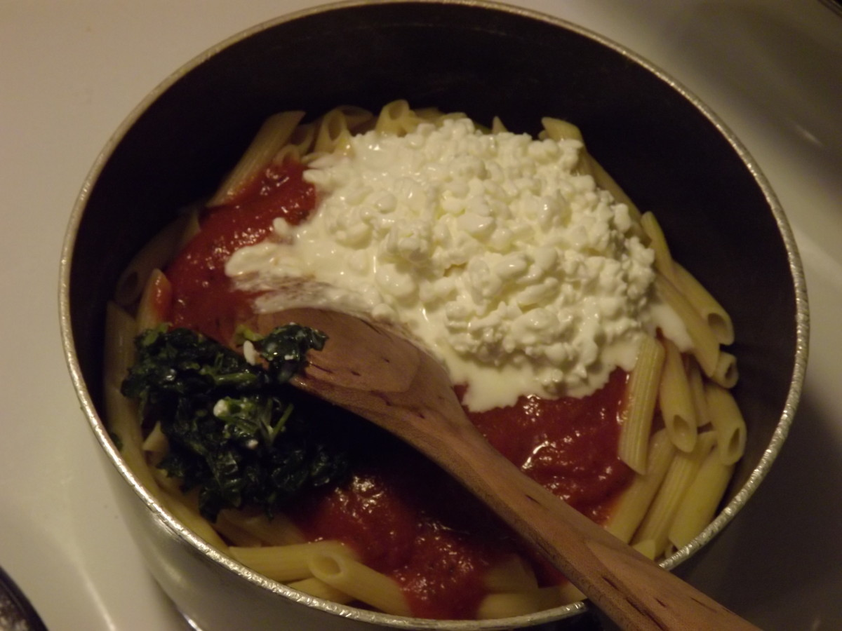 Pasta, cottage cheese, and spinach ready for stirring.