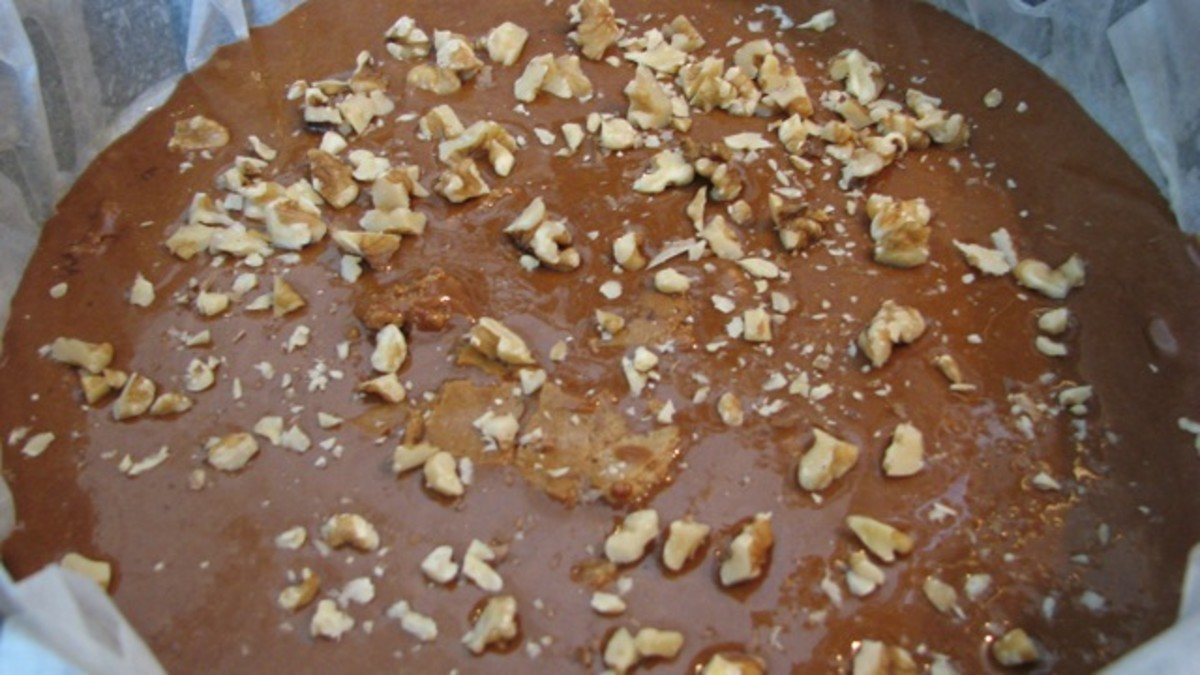 Toffee in pan, with walnuts sprinkled over it.