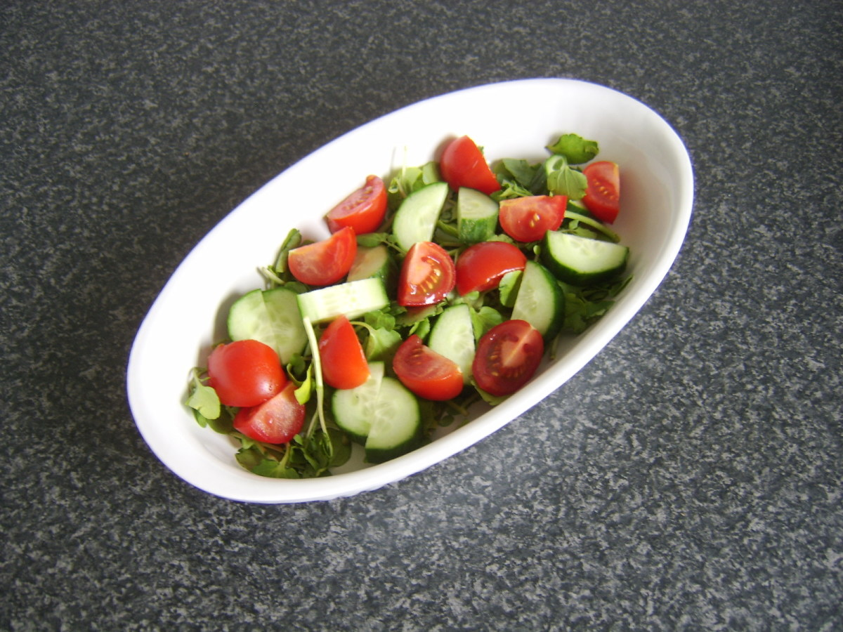 Salad for wraps is placed in a simple serving dish.