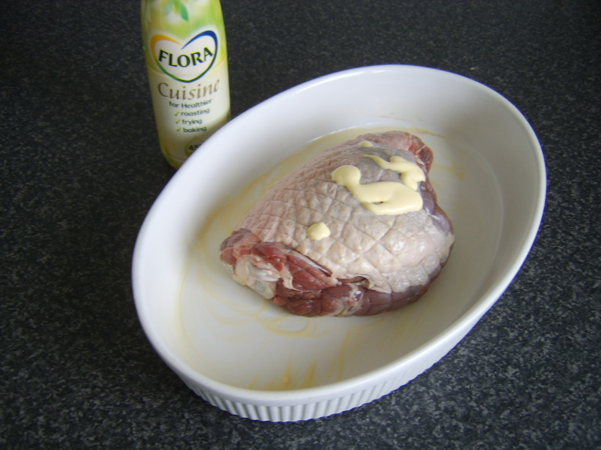 Thigh is rubbed with butter, olive oil or - as in this instance - an alleged at least heart healthy substitute for both