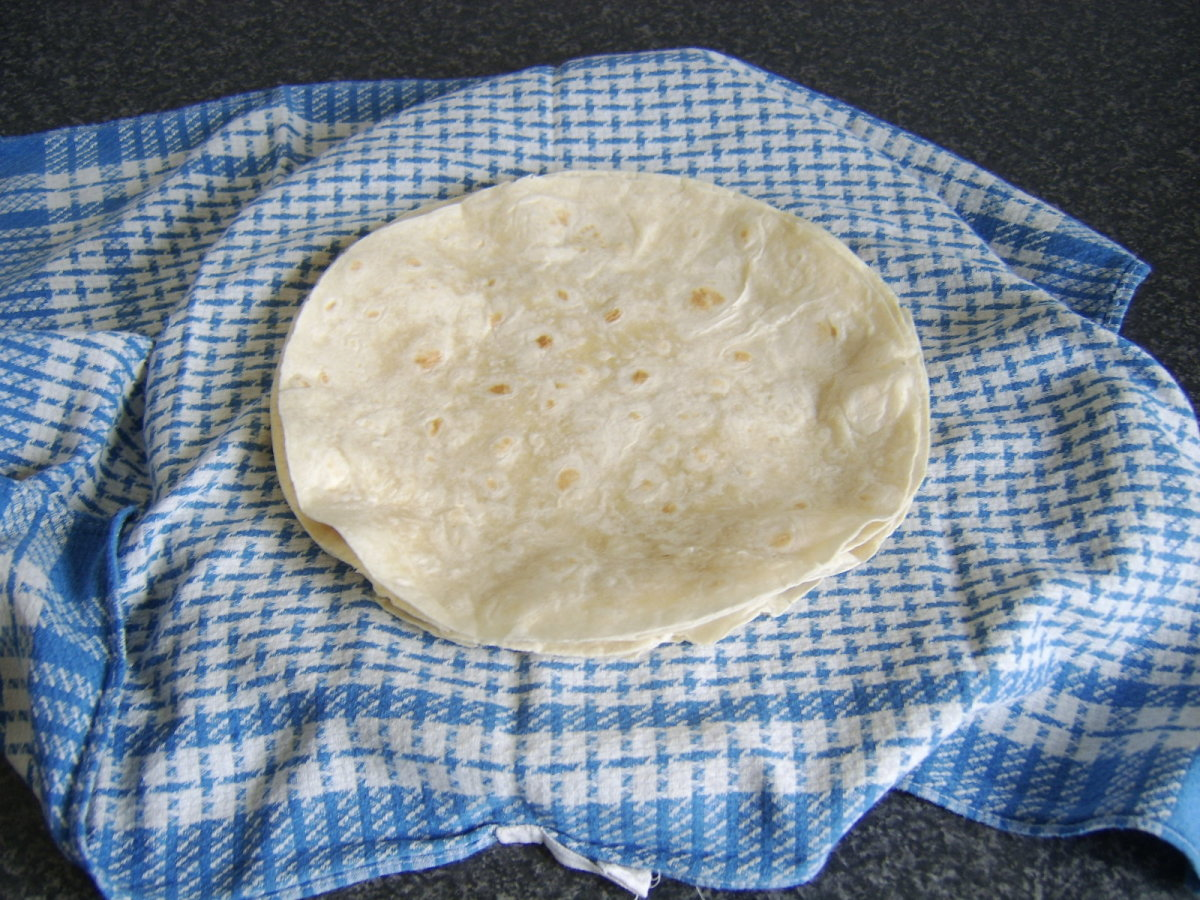 Wraps are heated one by one and kept moist in a warm, damp tea towel