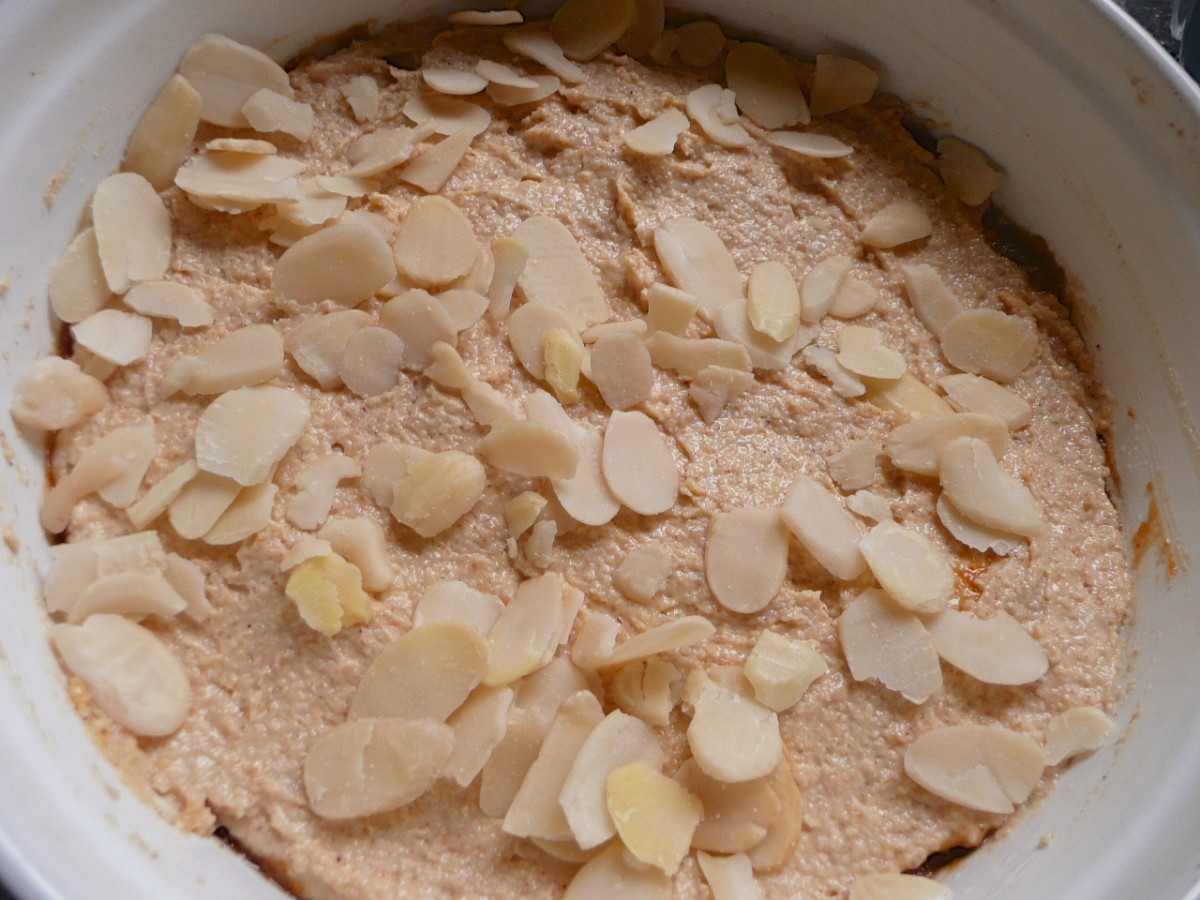 Spread with the rest of the cake mixture and then top with flaked almonds