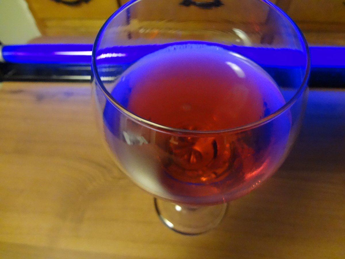The drink will look purple in normal light.