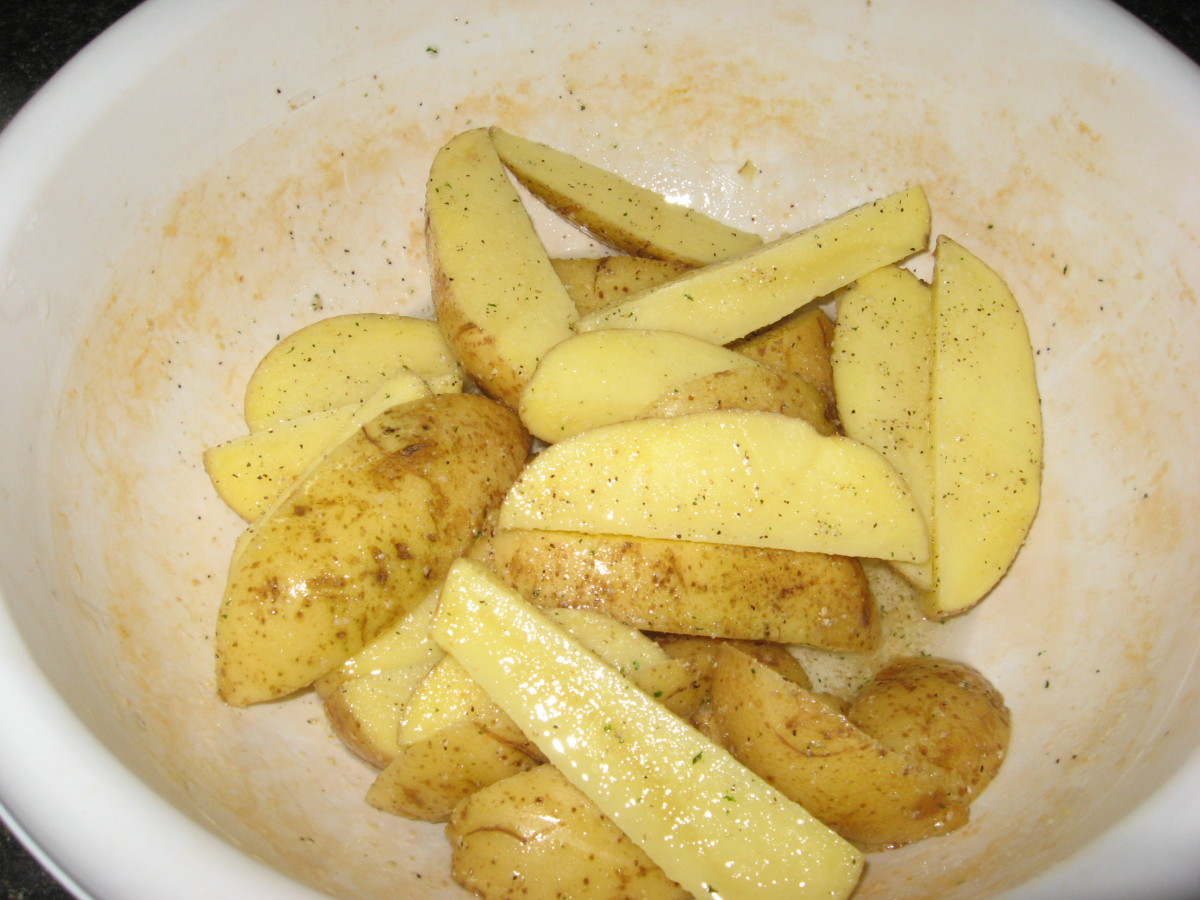 Toss potatoes with oil, garlic salt, onion powder, and rosemary.