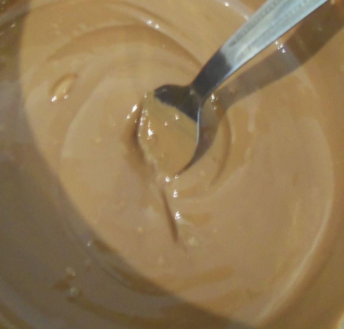 Melt the chocolate using a double boiler or in the microwave.
