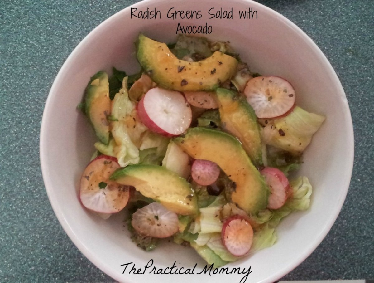 Radish greens salad with avocado and a peach mango dressing.