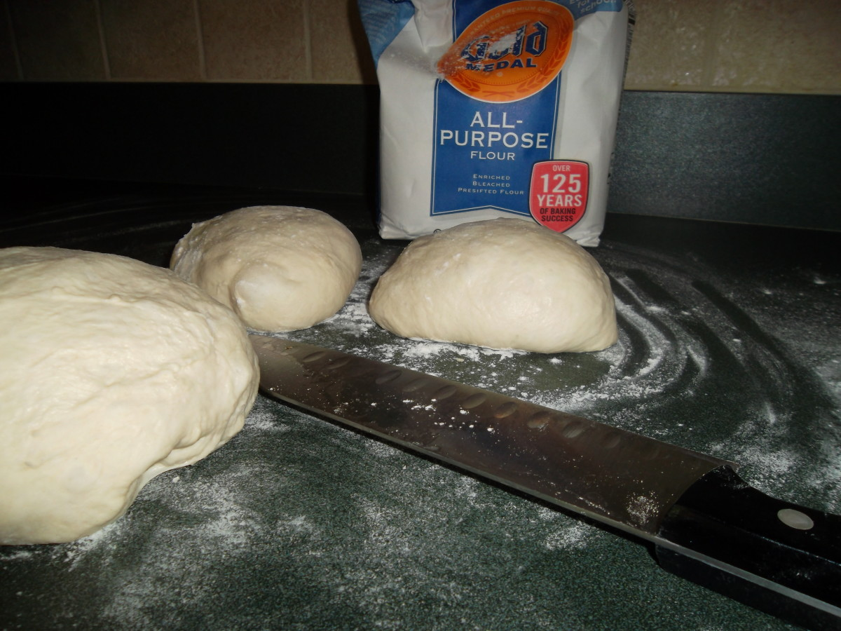 Divide the dough evenly, making four smaller balls; let it rest for five minutes.
