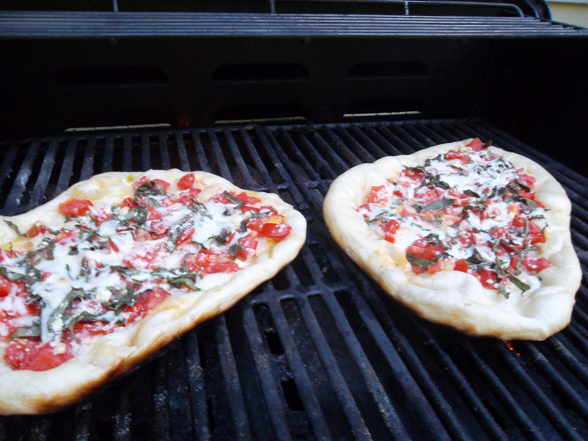 Grill the pizza for 3-4 minutes watching carefully and turning for even grilling.