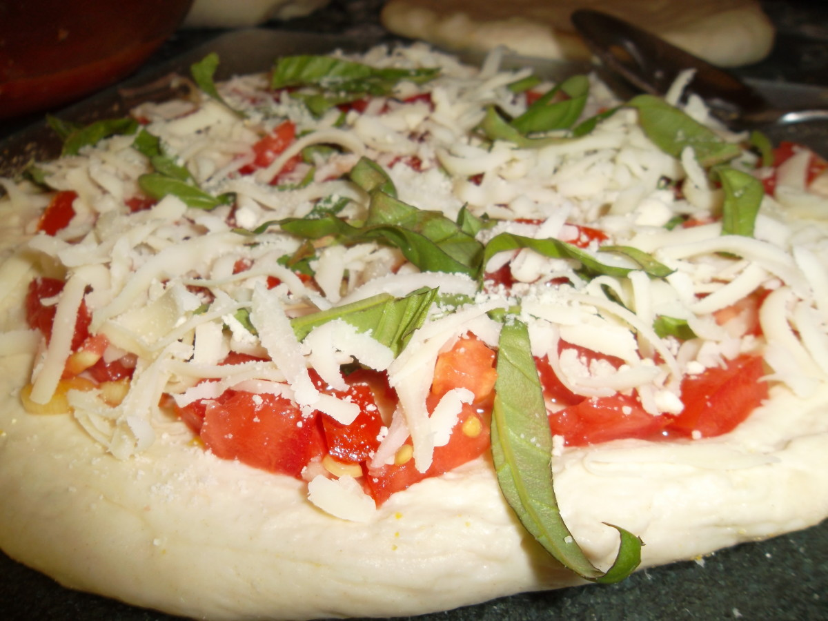 Add mozzarella cheese and some more basil for the final layer.