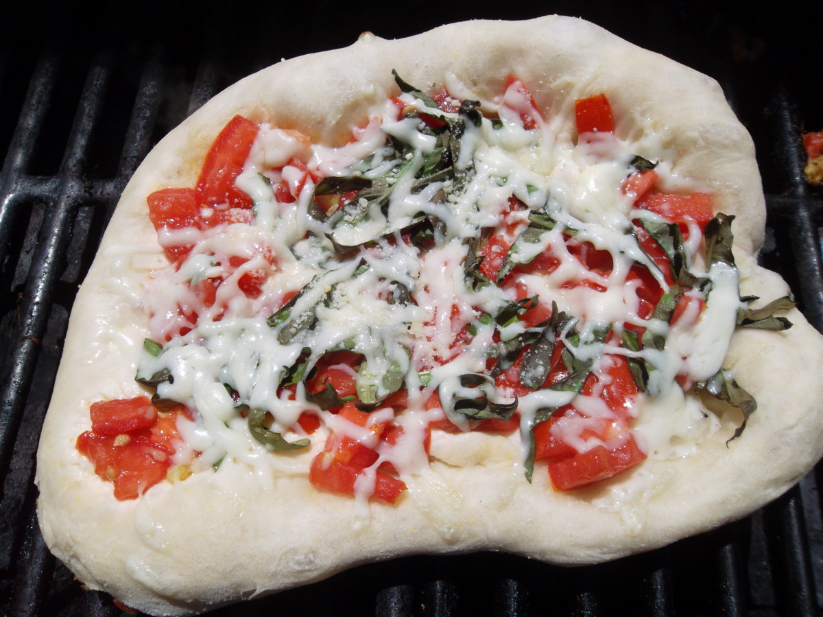 The pizza can be placed directly on the grill or on a pizza stone.