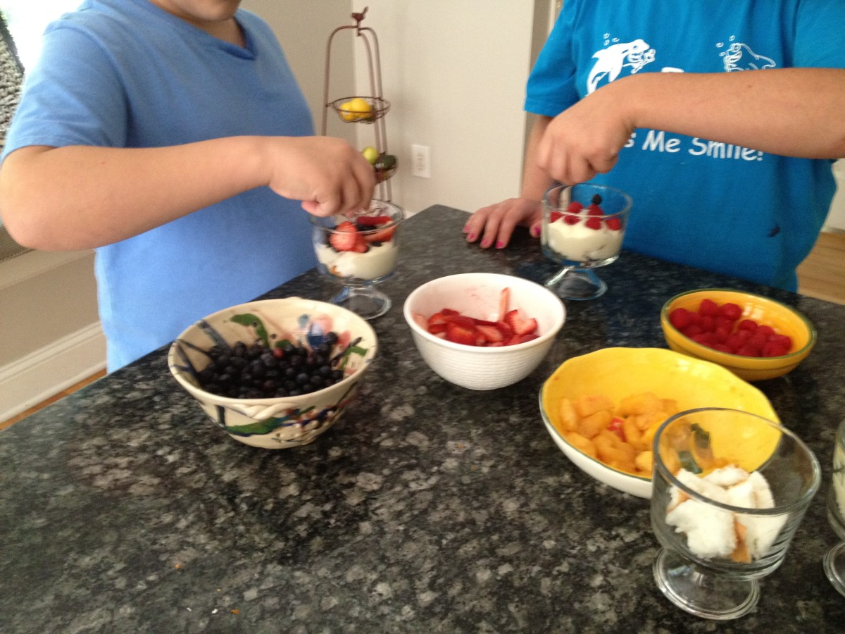 Kids have fun making their own mini trifle desserts.
