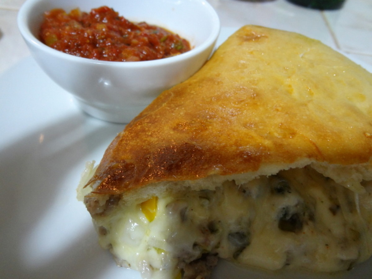 Italian Sausage Calzone with Garlicky Tomato Sauce
