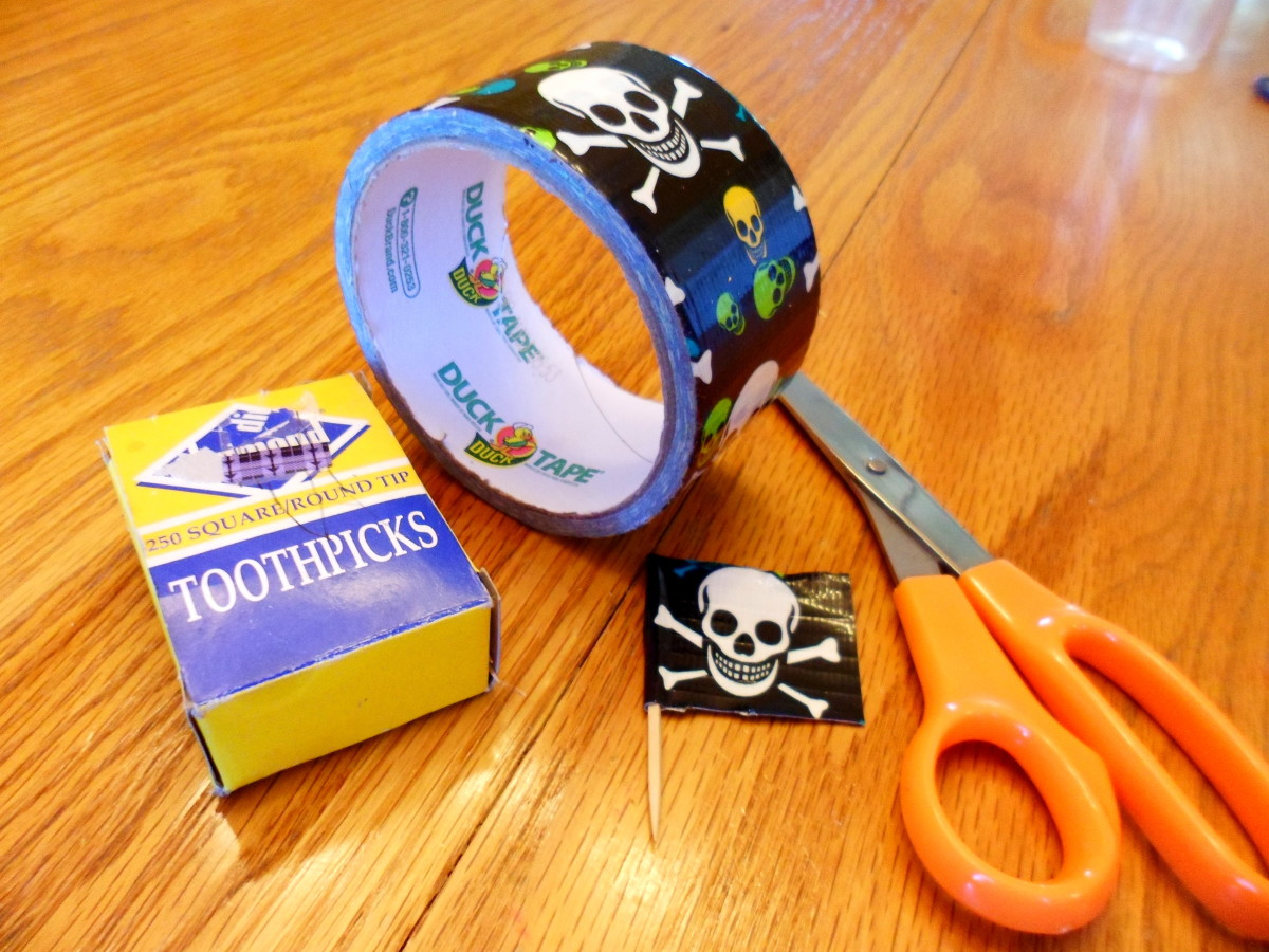 The supplies to make the cupcake toppers.