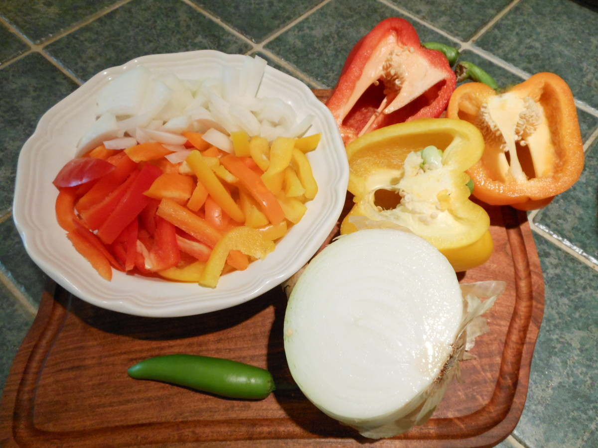 Slice red, orange and yellow peppers and onion into strips. Total veggies equals 4 cups. I used 1/4 of each pepper. and half of a medium white onion.