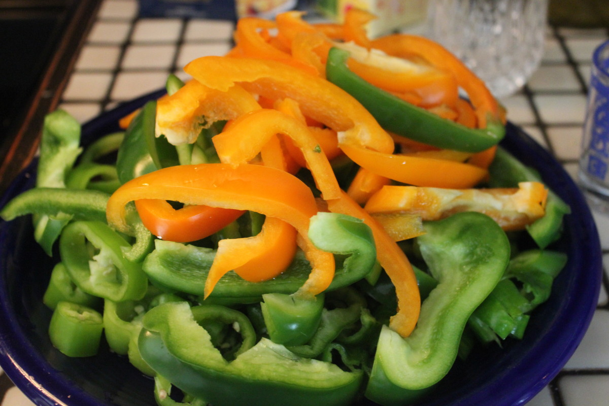 Orange and green Bell peppers. Anaheim, Cubanero and Long Hots