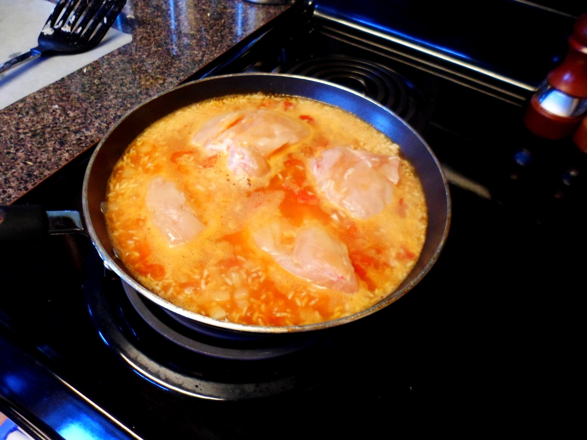 Add 4 chicken breasts to top of rice. Cover with lid and simmer for 25 minutes turning chicken over after 10 minutes.