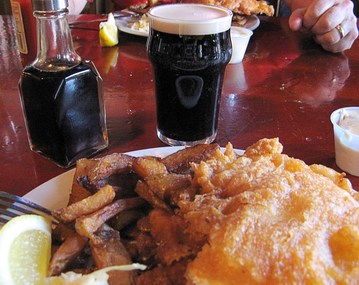 Fish and chips, Guinness, and malt vinegar