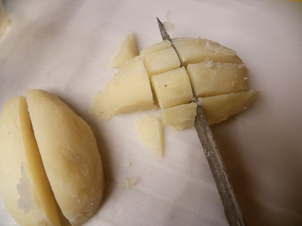 Step 7: Dice potatoes by cutting in half, then crosswise as you see in the picture.