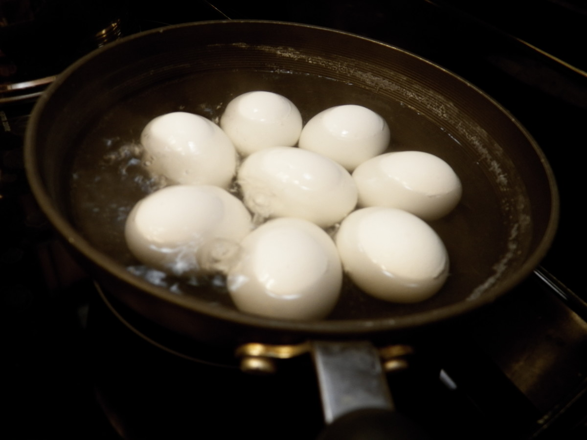 Step one: boil eggs: Cover eggs with water in pan.  Put on stove.  Heat to boiling.  Boil 12 minutes.