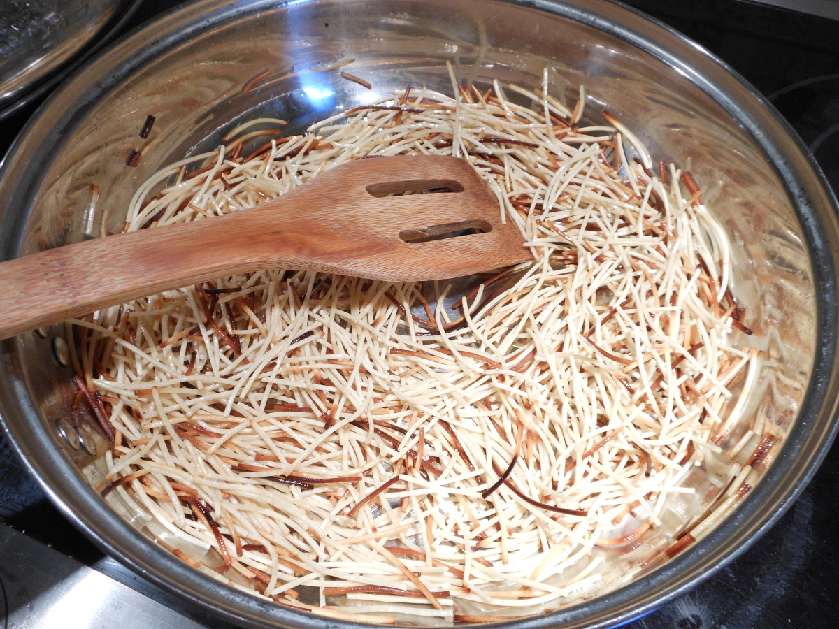 Place fideo (vermicelli) in a skillet and stir fry until brown over medium heat. (grease the skillet with 1 tablespoon of canola oil)