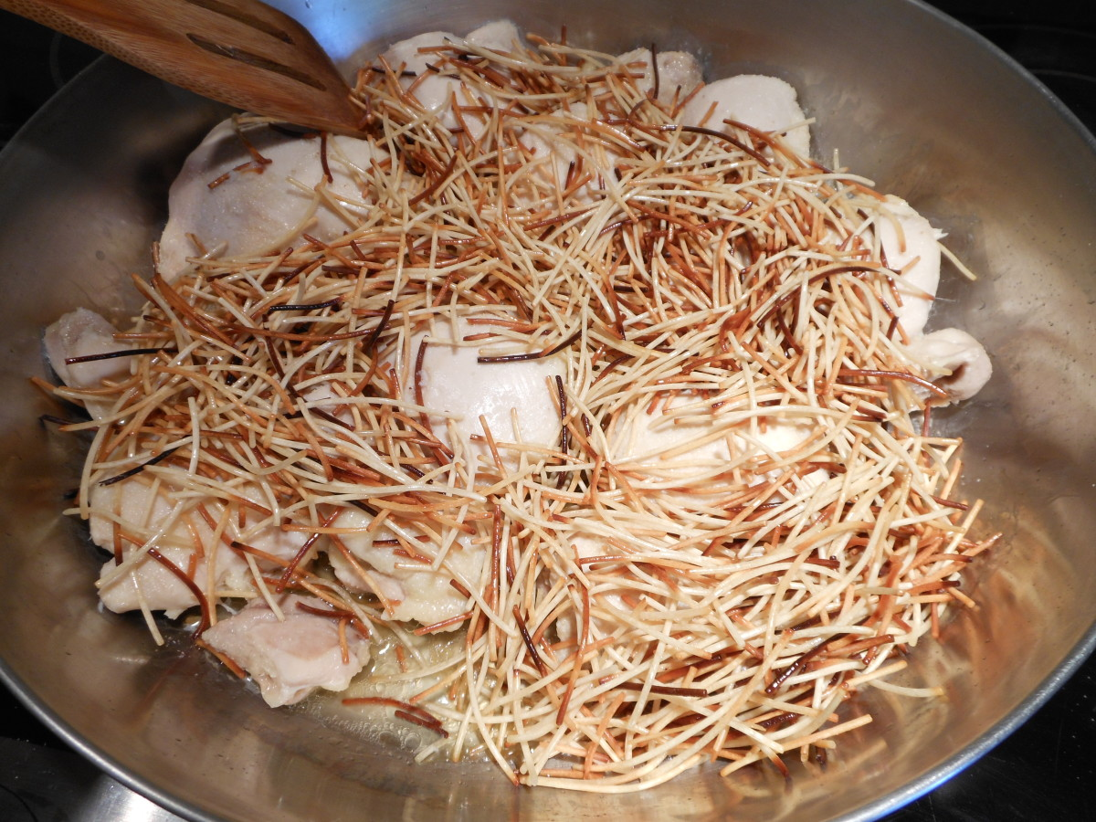 Add the browned fideo (vermicelli) over the cooked chicken.
